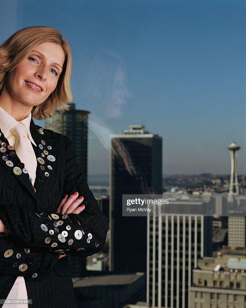 USA, Washington, Seattle, woman smiling, arms crossed, portrait : Stock Photo