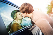USA, Washington, Seattle, Young couple kissing through window of car