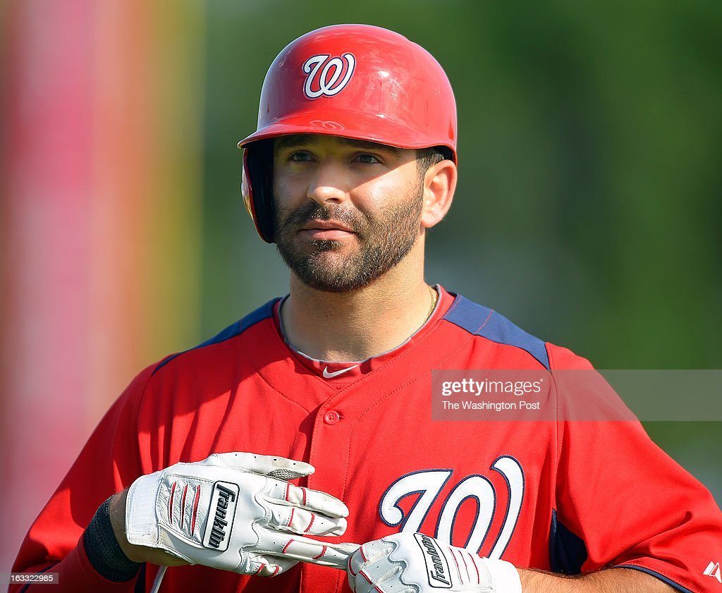 Washington second baseman Danny Espinosa (8) pulls off his batting gloves after getting thrown out at first during the Washington Nationals loss to the Miami Marlins 5 - 1 in Grapefruit League baseball in Viera FL, February 27, 2012 .