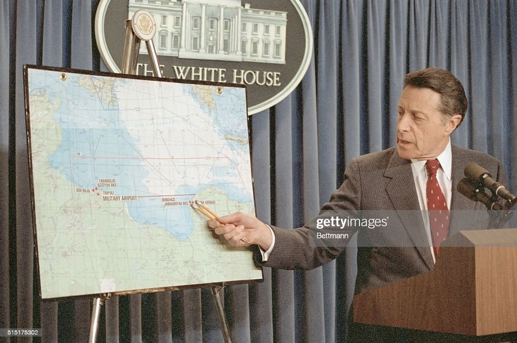 Secretary of Defense Caspar Weinberger uses a map to explain the US air strikes against Libya during a White House briefing