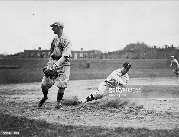 Washington Senators' Bucky Harris slides as he successfully steals third base in the 7th inning of a baseball game against the Boston Red Sox third...