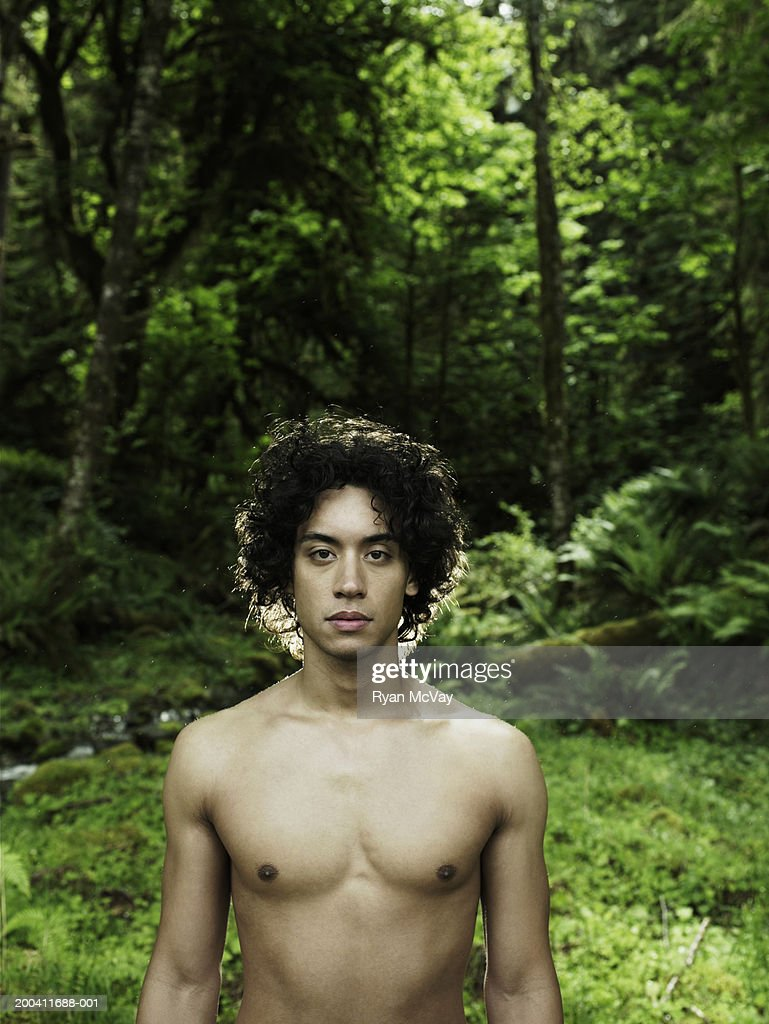 USA, Washington, shirtless young man in Quinault Rainforest, portrait : Stock Photo