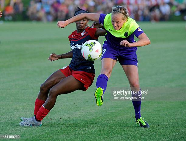 Washington Spirit defender Crystal Dunn and Seattle Reign FC defender Elli Reed battle for possession in the first half at Maureen Hendricks Field at...