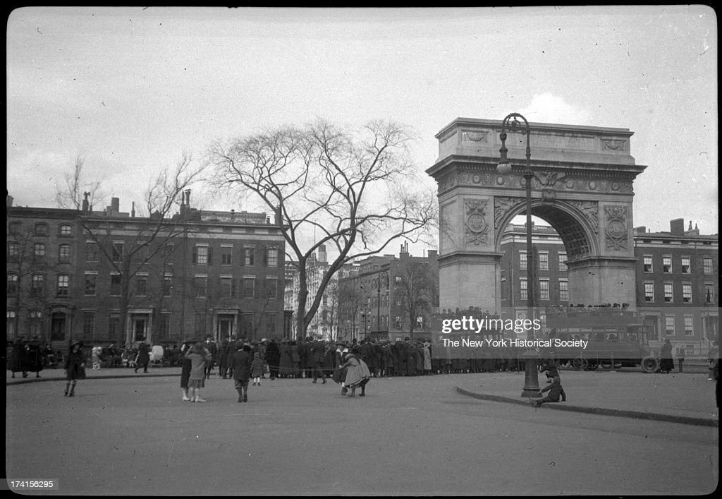 Washington Square Park and arch doubledecker buses visible New York New York late 19th or early 20th century