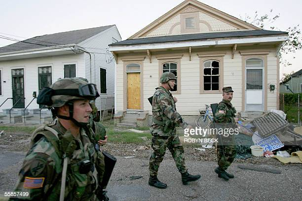 Washington state Army National Guard return to their vehicles after responding to a house fire in the Faubourg Marigny section of New Orleans 05...