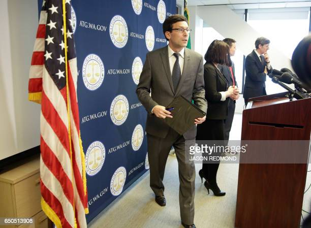 Washington State Attorney General Bob Ferguson leaves a press conference after saying he will ask a federal judge to block US President Donald...