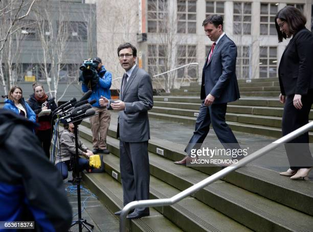 Washington State Attorney General Bob Ferguson Solicitor General Noah Purcell and Civil Rights Unit Chief Colleen Melody arrive to address the media...