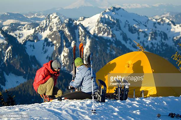 USA, Washington State, Cascade Mountains, two hikers resting at camp site in mountains