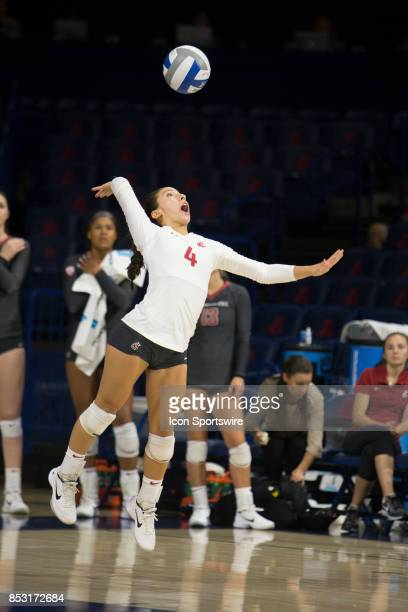 Washington State Cougars defensive specialist Alexis Dirige serves the ball during a college volleyball game between the Washington State Cougars and...