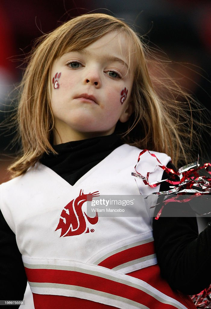 A Washington State Cougars fan dressed as a cheerleader during the game between the Washington Huskies and the Washington State Cougars at Martin Stadium on November 23, 2012 in Pullman, Washington.