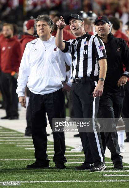 Washington State Cougars head coach Mike Leach talks with an official as a Targeting call is reviewed during the game between the USC Trojans and the...