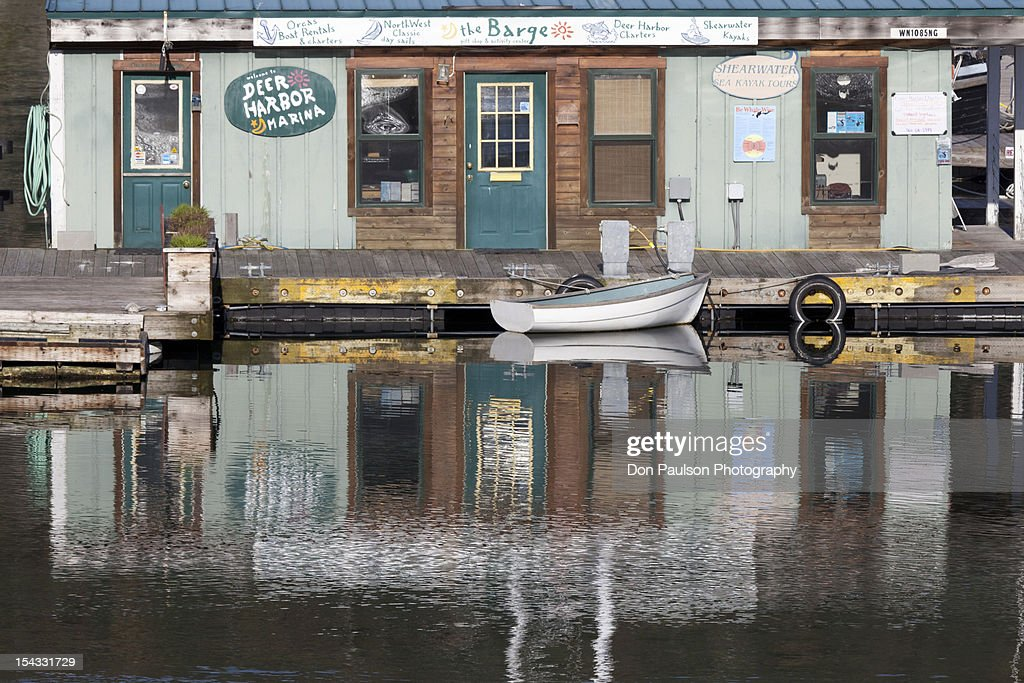 USA, Washington State, Deer Harbor, Orcas Island, Building reflecting in water