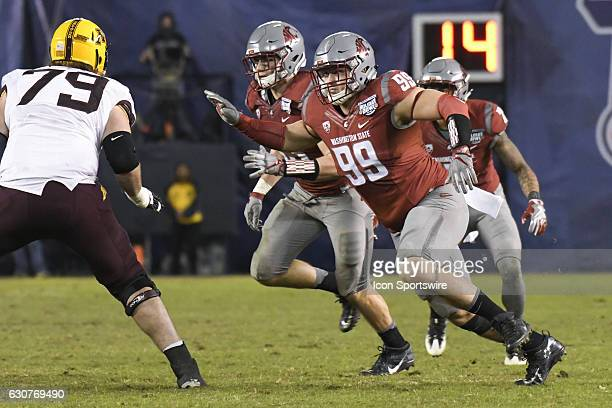 Washington State Garrett McBroom tries to apply pressure to the quarterback during the National Funding Holiday Bowl game between the Minnesota...