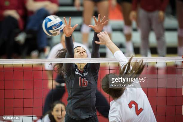 Washington State outside hitter Savanah Smith tries to block a spike from Nebraska outside hitter Mikaela Foecke in the second set Saturday December...