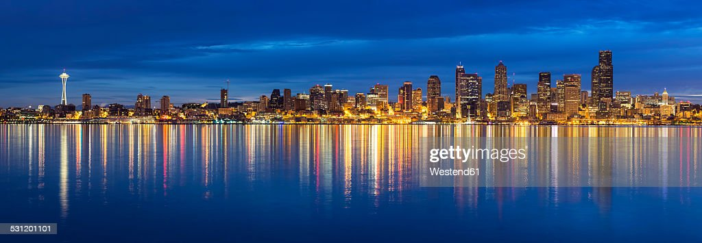USA, Washington State, Puget Sound and skyline of Seattle with Space Needle at blue hour