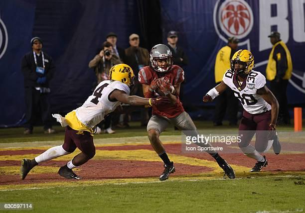 Washington State Robert Lewis catches the ball against Minnesota Zo Craighton and Minnesota Eric Amoako but fails to break the plane of the endzone...
