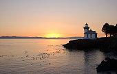 USA, Washington State, San Juan Island, lighthouse, sunset