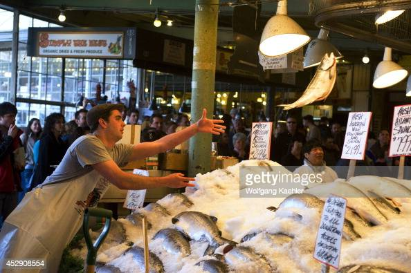 USA Washington State Seattle Pike Place Market Fresh Seafood Stand Flying Fish Show Vendor Throwing Salmon