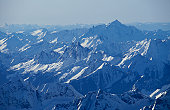 USA, Washington State, snow covered North Cascade Mountains, aerial view