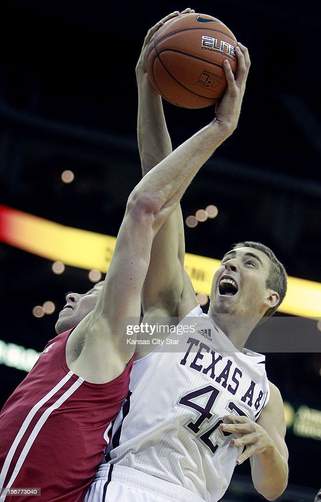 Washington State's Brock Motum, left, and Texas A&M's Jarod Jahns lock arms while battling for a rebound during the first half of the consolation game of the CBE Hall of Fame Classic at the Sprint Center in Kansas City, Missouri, on Tuesday, November 20, 2012.