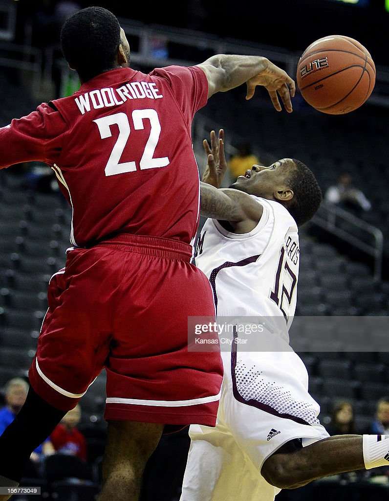 Washington State's Royce Wooldridge (22) blocks the shot of Texas A&M's Fabyon Harris during the first half of the consolation game of the CBE Hall of Fame Classic at the Sprint Center in Kansas City, Missouri, on Tuesday, November 20, 2012.