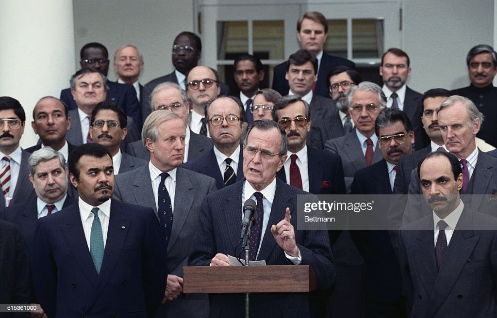 Surrounded by Ambassadors whose countries are involved in the Persian Gulf crisis President Bush tells reporters he remains firm on dates for talks...
