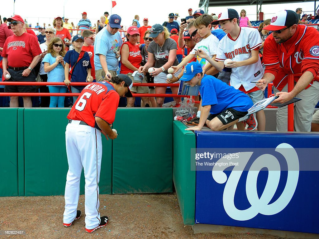 Washington third baseman Anthony Rendon (6) signs autographs for Nats fans before the Florida Marlins play the Washington Nationals in Grapefruit League baseball in Viera FL, February 24, 2012 .
