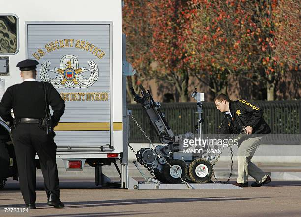 A bomb disposal robot is unloaded from a truck on Pennsylvania Avenue after a suspicious package was found outside a building near the White House 05...