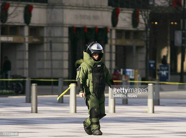 A bomb disposal technician in a protective suit walks down Pennsylvania Avenue after a suspicious package was found outside a building near the White...