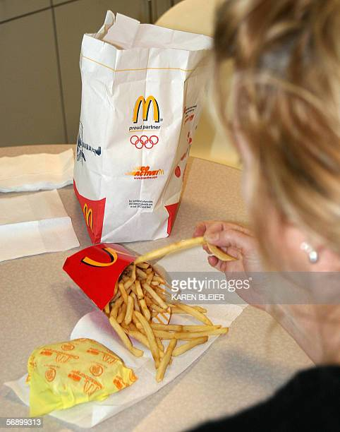 A consumer eats french fries 21 February 2006 in WashingtonDC Fastfood giant McDonald's is being sued in the United States for failing to warn that...