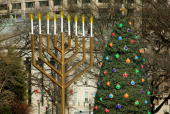 A large Menorah and the National Christmas Tree stand on the Elipse opposite the White House during the annual holiday season 19 December 2006 in...