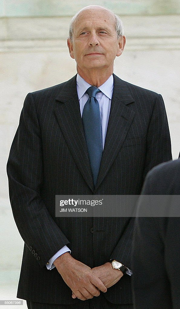 Associate Supreme Court Justice Stephen Breyer waits on the steps of the US Supreme Court in Washington DC 06 September 2005 for the casket of US...