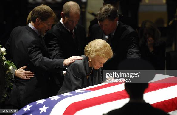 Betty Ford pauses at the flag draped casket of her husband and former US president Gerald R Ford as he lies in state in the Rotunda of the US Capitol...
