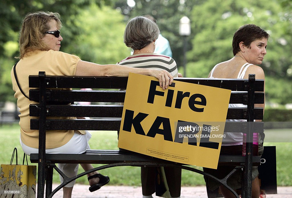 Demonstrators demanding the resignation of top White House political advisor Karl Rove who has been accused of leaking the identity of a covert CIA...