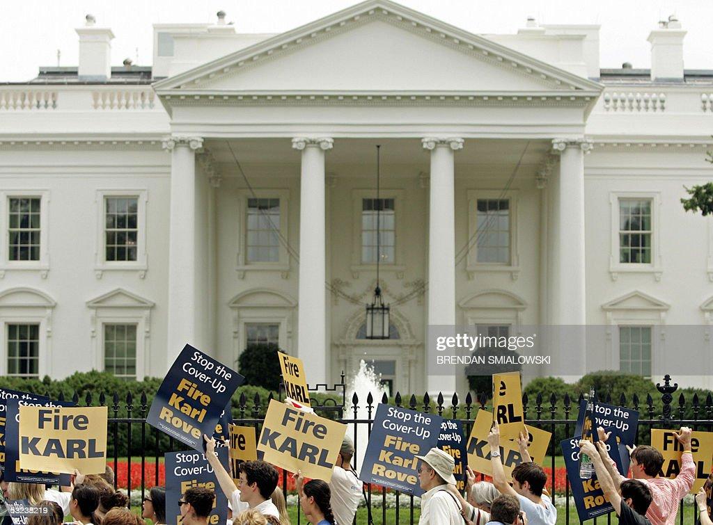 Demonstrators gather outside the White House in Washington 14 July 2005 demanding the resignation of top White House political advisor Karl Rove who...