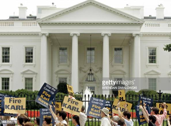 Demonstrators gather outside the White House in Washington 14 July 2005 demanding the resignation of top White House political advisor Karl Rove who...