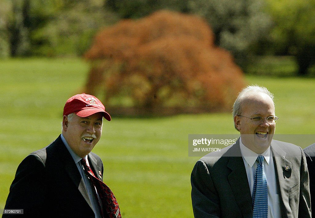 Executive Secretary of the National Security Council Phil Lago (L) laughs with White House chief political advisor Karl Rove 05 April,2006 on the south lawn of the White House in Washington, DC, after returning from Bridgeport, Connecticut, where US President George W. Bush spoke on healthcare . AFP PHOTO/Jim WATSON