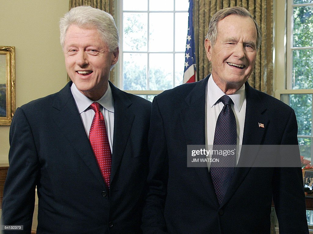 Former US Presidents George H.W. Bush(R) and <a gi-track='captionPersonalityLinkClicked' href=/galleries/search?phrase=Bill+Clinton&family=editorial&specificpeople=67203 ng-click='$event.stopPropagation()'>Bill Clinton</a> smile as they leave the Oval Office 01 September, 2005 at the White House in Washington, DC. The two former presidents were tapped by US President George W. Bush to lead a private fund-raising campaign for victims as they did for last year's Asian tsunami. AFP PHOTO/Jim WATSON