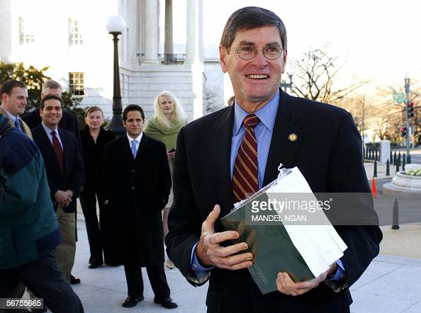 House Budget Committee Member Representative Jim Ryun RKS speaks to reporters while holding a copy of the FY2007 budget in front of the Cannon House...