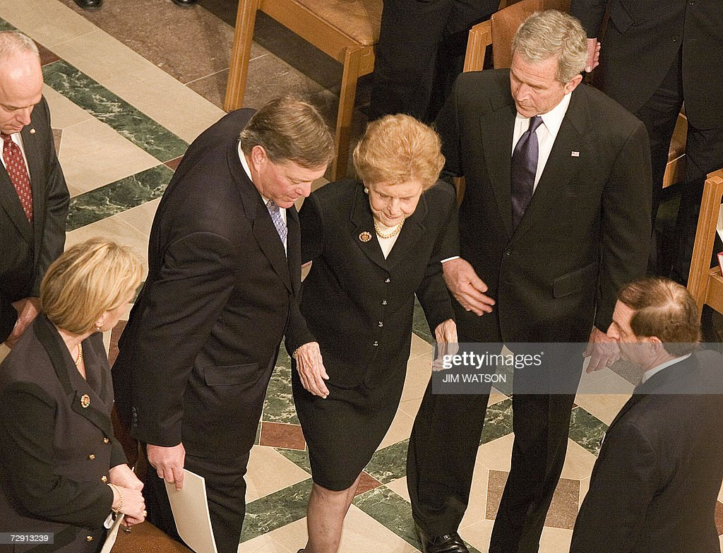 Jack Ford helps his mother Former First Lady Betty Ford after US President George W Bush escorted her to her seat during former President Gerald R...