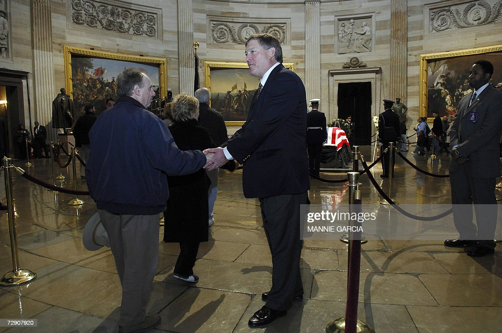 Jack Ford son of US President Gerald R Ford greets mourners before his father's casket in the Rotunda of the US Capitol 31 December 2006 in...