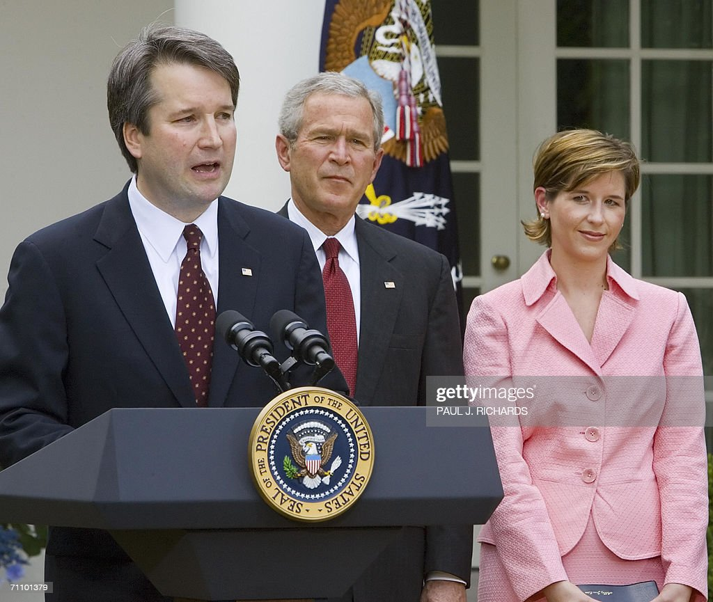 Judge Brett Kavanaugh(L) delivers remarks after being sworn in as a Judge to the US Court of Appeals for the District of Columbia as US President George W. Bush (C) and Kavanaugh's wife Ashley listen during ceremonies 01 June 2006 in the Rose Garden of the White House in Washington,DC. AFP Photo/Paul J. Richards