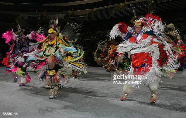 Native Americans dance as the National Pow Wow get under way 12 August 2005 at the MCI Center in Washington DC Representatives from many of America's...