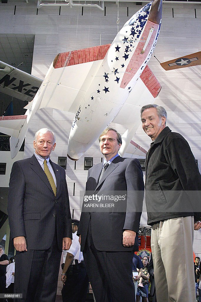 SpaceShipOne designer Burt Rutan(R) stands with project donor Paul Allen and museum director Gen. Jack Dailey(L) at the Smithsonian National Air and Space Museum in Washington, DC 05 October, 2005 as Paul Allen(R) project donor looks on. SpaceShipOne, the world's first privately built and piloted vehicle to reach space, was donated to the National Air and Space Museum during a brief ceremony. The SpaceShipOne craft hangs in the background(L). AFP PHOTO/Karen BLEIER