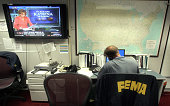 The Federal Emergency Management Agency Command Center is a beehive of activity 30 August 2005 in downtown Washington DC handling all logistics of...