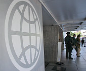 The logo of the World Bank is seen at the entrance to the building 08 May 2007 in Washington DC World Bank president Paul Wolfowitz's hold on his job...