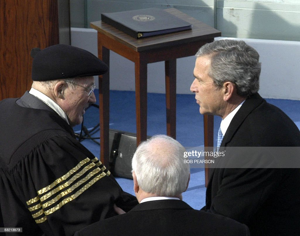This 20 January 2005 file photo shows US President George W. Bush (R) greeting US Chief Justice William Rehnquist (L) before US Vice President Dick Cheney (C) during inaugural ceremonies on Capitol Hill in Washington, DC. A battle for the political soul of the US Supreme Court erupted following the retirement announcement by US Justice Sandra Day O'Connor 01 July 2005, with many expecting the ailing Rehnquist, 80, to follow suit. Bush, congressional leaders and lobby groups are now girding for a fight over the potential twin vacancies on the top US court. AFP PHOTO/Bob PEARSON