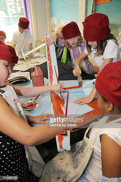 TO GO WITH AFP STORY USSOCIETYEDUCATIONHEALTHCHILDREN Students paint a model aircraft they made based on a design by Leonardo da Vinci during a...
