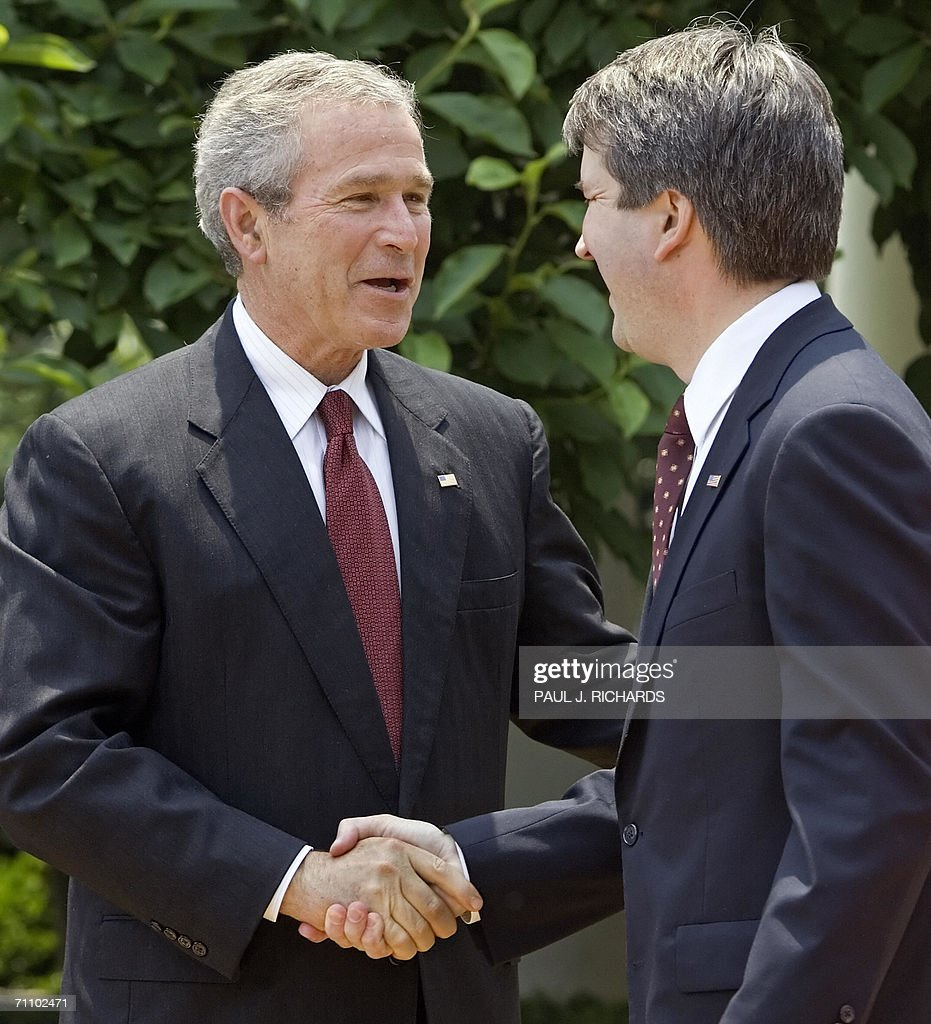 US President George W. Bush (L) congratulates Judge Brett Kavanaugh after he was sworn-in as Judge to the US Court of Appeals for the District of Columbia during ceremonies 01 June 2006 in the Rose Garden of the White House in Washington,DC. AFP Photo/Paul J. Richards