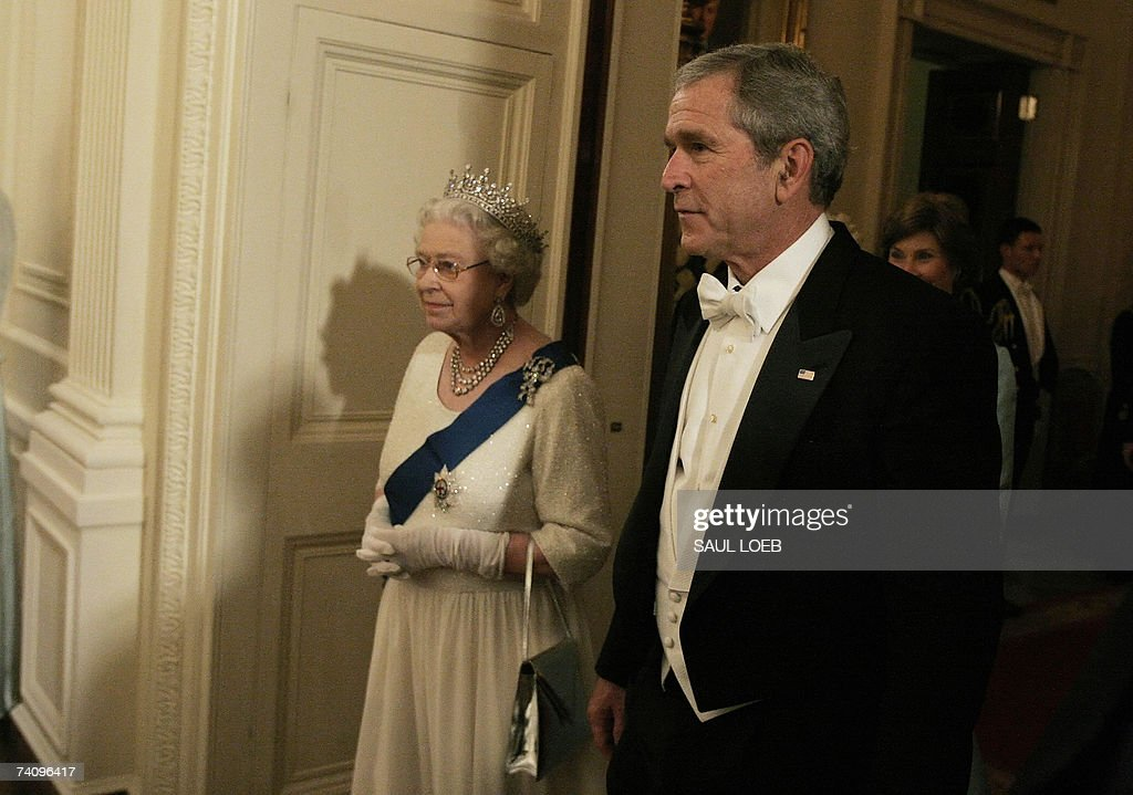 US President George W. Bush escorts Queen <a gi-track='captionPersonalityLinkClicked' href=/galleries/search?phrase=Elizabeth+II&family=editorial&specificpeople=67226 ng-click='$event.stopPropagation()'>Elizabeth II</a> prior to a performance by violinist Itzhak Perlman in the East Room of the White House in Washington, DC, 07 May 2007. The British monarch and the US president solemnly toasted the tight bonds between their countries, in the grandest White House dinner of Bush's administration.